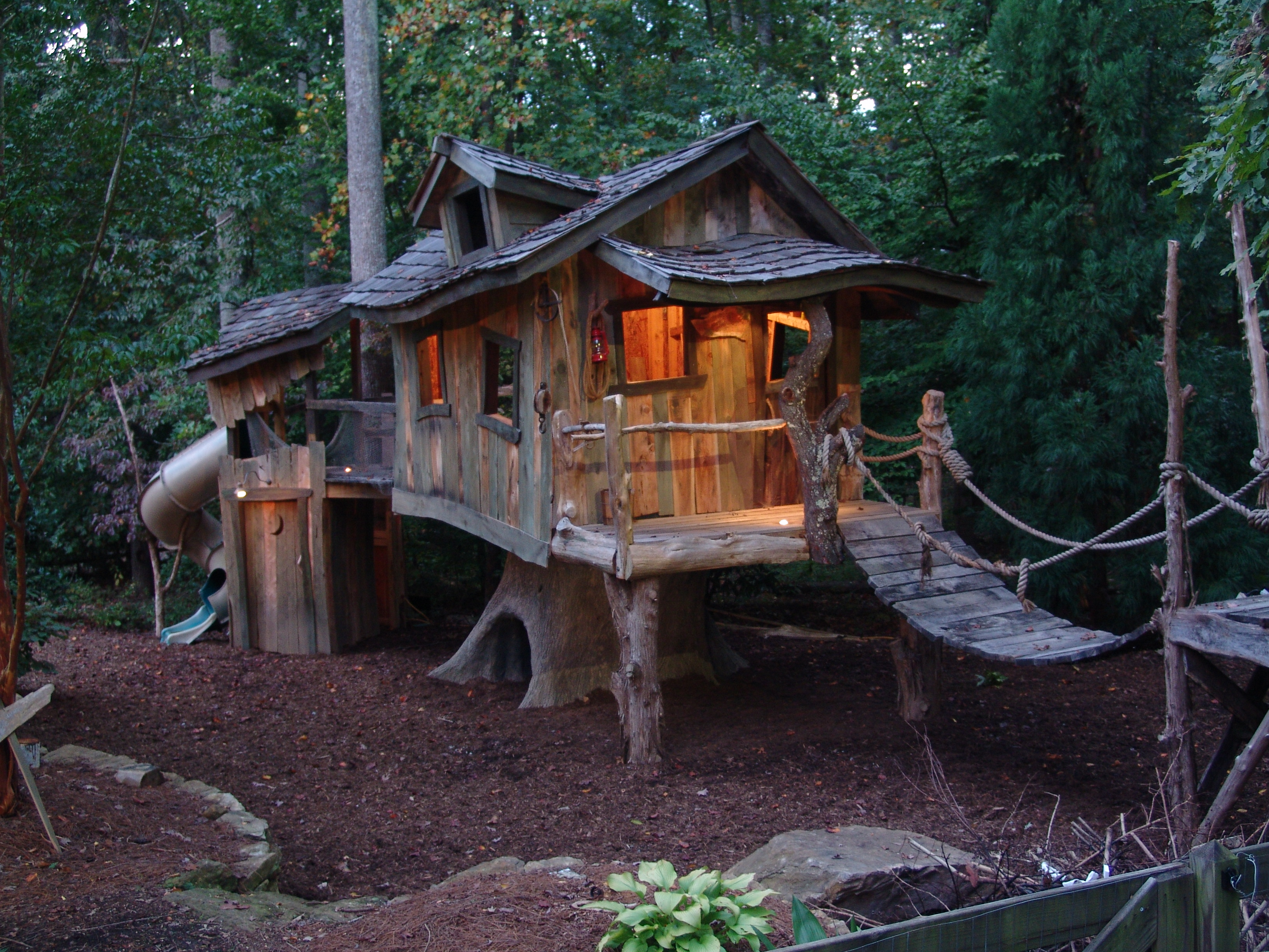 Creative Garden Spaces Inc, Oak Ridge NC, custom tree house construction, landscape lighting, tree house bridge