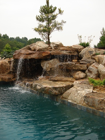 Creative Garden Spaces Inc, water feature, pool waterfall, natural waterfall, landscape boulders, custom stonework
