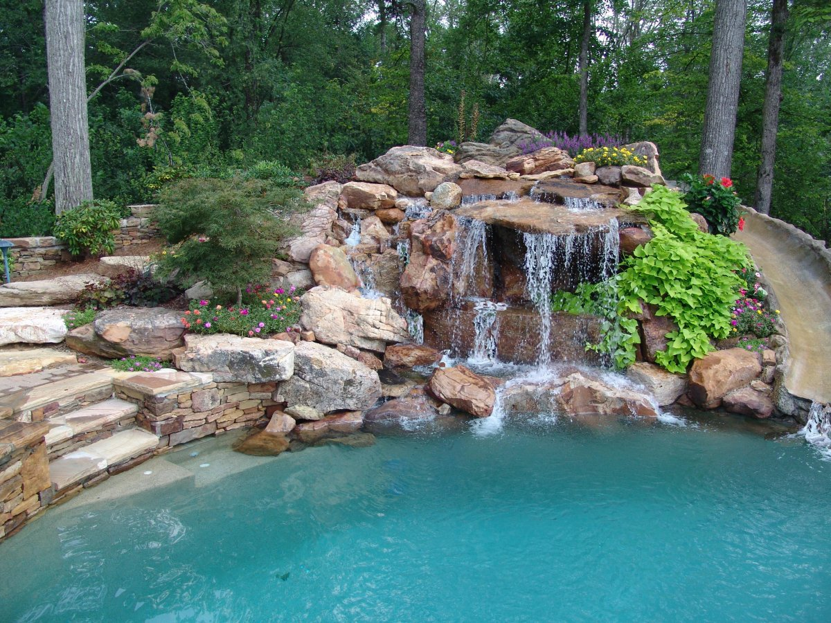 Creative Garden Spaces Inc, water feature, pool waterfall, natural waterfall, waterslide, custom stonework, stone steps, landscape boulders