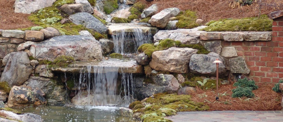 Creative Garden Spaces Inc, water feature, natural waterfall, koi pond, creative landscape design, landscape boulders