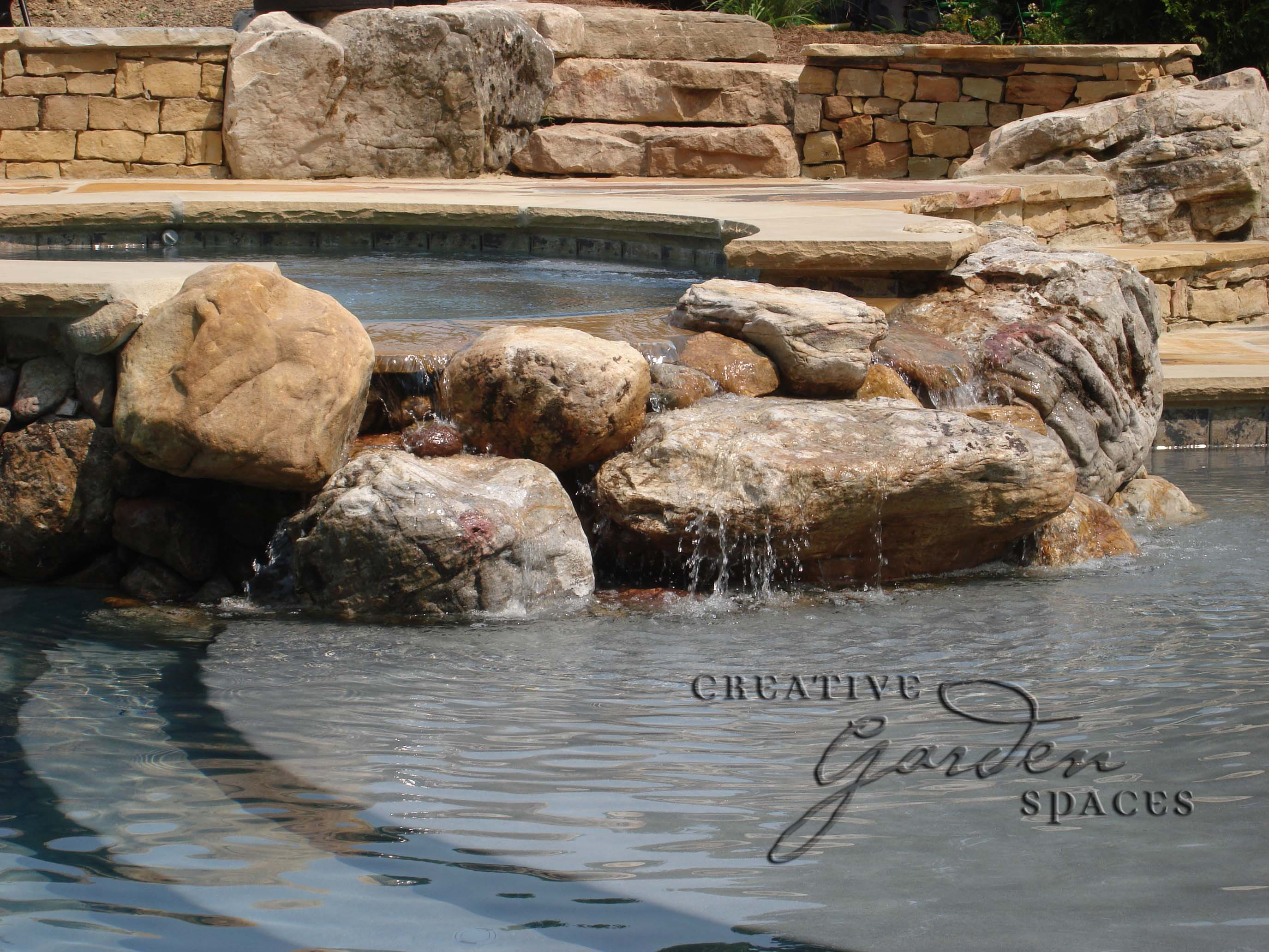 Creative Garden Spaces Inc, D.H. Griffin, Greensboro NC, pool waterfall, natural waterfall, water feature, pool fountain, landscape boulders, custom stonework