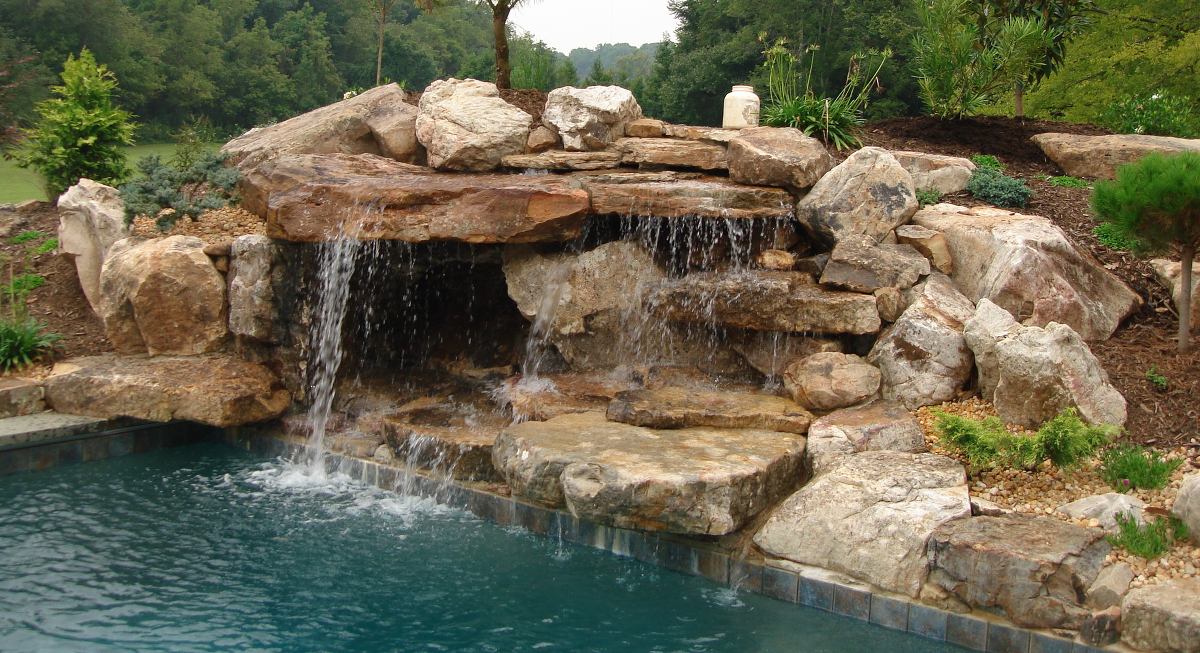 Pool waterfalls creative garden spaces for Pool waterfall